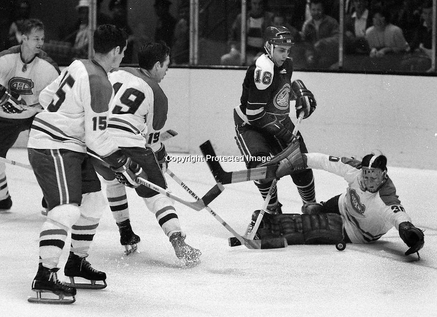 Seals vs Montreal Canadians goalie Rogatien Vachon saves shot by California Golden Seals Ted Harris, Bobby Rousseau #15,and Terry Harper #19.(1969 photo/Ron Riesterer)