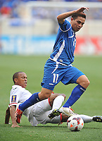 Rodolfo Zelaya Garcia (11) of El Salvador goes against Densit Theobald (18) of Trinidad & Tobago.  Trinidad & Tobago tied El Salvador 1-1 in the first round of the Concacaf Gold Cup, at Red Bull Arena, Monday July 8 , 2013.