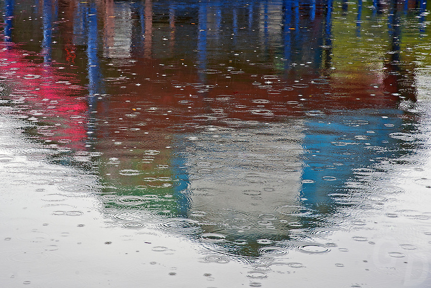 Abstract reflections in Water during a Monsoon rain shower on the Tonle Sap, Cambodia