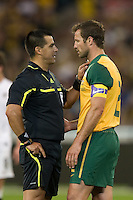 MELBOURNE, AUSTRALIA - MAY 24, 2010: Lucas Neill of the Qantas Socceroos is spoken to by the match referee Ricardo Salazar at the FIFA World Cup farewell match between Australia and New Zealand at the Melbourne Cricket Ground, 24 May, 2010 in Melbourne, Australia. Photo by Sydney Low / www.syd-low.com