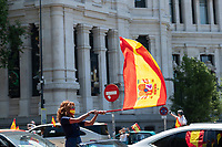 MADRID, SPAIN - MAY 23: A woman waves a Spanish flag from a car during the demonstration organized by VOX, Spanish far-right party and third biggest party in the Parliament, to demand the resign of the national Government on 23 May 2020, in Madrid, Spain. This protest, which should be participated from the car, occurs in the middle of deescalation plans of covid 19 and the state of emergency remains active due to the coronavirus. (Photo by Sergio Belena / VIEWpress).