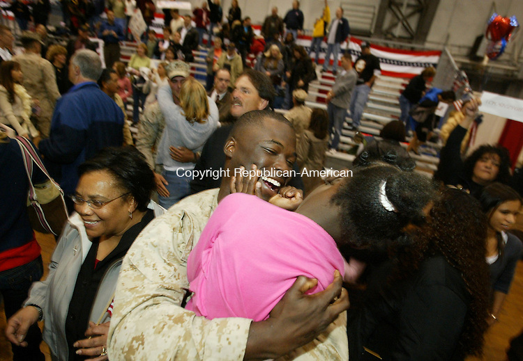 HARTFORD, CT; 25 OCTOBER 2006; 102506BZ18- Cpl. Craig Washington, of Springfield, MA., hugs his daughter Zarria Washington, 5, during a returning troop ceremony at the State Armory Wednesday night.  Washington said he works for the State ot Connecticut.<br /> Troops from Company C, 1st Battalion 25th Marines returned to the State Armory in Hartford Wednesday night after serving for seven months in Fallujah, Iraq.  <br />  Jamison C. Bazinet Republican-American