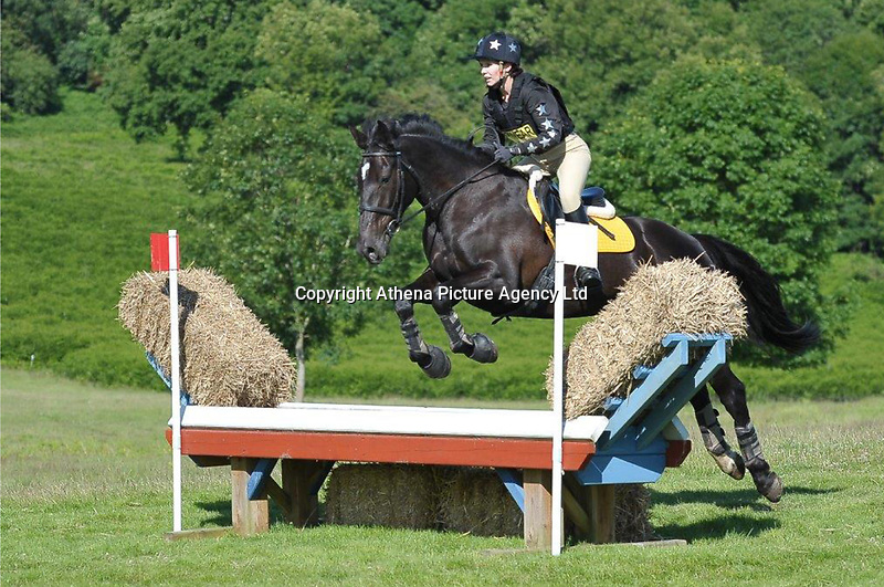 """Pictured: Elise David taking part in a show jumping equestrian event.<br /> Re: NHS manager Elise David, 33, who went showjumping while on sick leave has told Newport Crown Court that she was in """"too much pain to work"""".<br /> The lab worker from Nottage near Bridgend, took four months off work, saying she felt fit enough to ride but not to do her job.<br /> Ms David denies fraud after being paid about £12,000 of her £49,000 salary while off work.<br /> She rode in four equestrian events after doctors told her to do """"gentle exercise""""."""