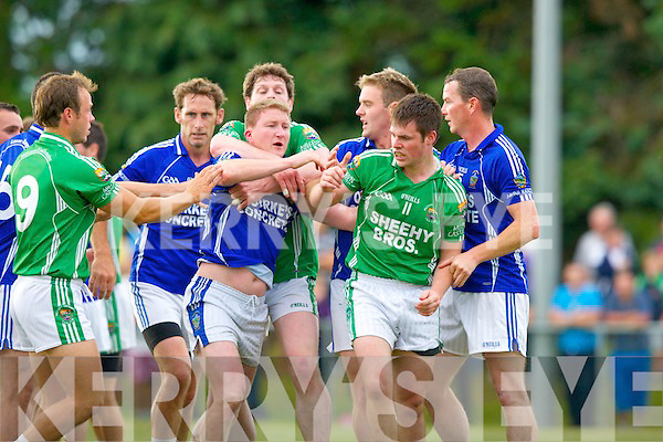 Mike Frank Russell laune Rangers is held back by Mike Burke as he tries to get to Shane McKenna Milltown during their feisty  County Championship clash in Milltown Sunday evening