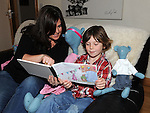 Jillian Stout reading her new book to her son Dylan. Photo: Colin Bell/pressphotos.ie