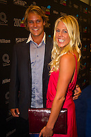 GOLD COAST, Queensland/Australia (Friday, February 24, 2012) Granger Larsen (HAW) with girlfriend Laura Enever (AUS).  The 29th Annual ASP World Surfing Awards went off tonight at the Gold Coast Convention and Exhibition Centre with the worlds best surfers trading the beachwear for formal attire as the 2011 ASP World Champions were officially crowned.. .Kelly Slater (USA), 40, and Carissa Moore (HAW), 19, took top honours for the evening, collecting the ASP World Title and ASP Womens World Title respectively.. .I have actually been on tour longer than some of my fellow competitors have been alive, Slater said. All joking aside, its truly humbling to be up here and honoured in front of such an incredible collection of surfers. I want to thank everyone in the room for pushing me to where I am...In addition to honouring the 2011 ASP World Champions, the ASP World Surfing Awards included new accolades voted on by the fans and the surfers themselves...For the first time in several years, ASP Life Membership was awarded to Hawaiian legend and icon of high-performance surfing, Larry Bertlemann (HAW), 56...Where surfing is today is where I dreamed it should be in the 70s, Bertlemann said. You guys absolutely deserve this and Im so honored to be up here in front of you all tonight..Grammy Award-winning artists Wolfmother and The Vernons rounded out the nights entertainment which was all streamed LIVE around the world on YouTube.com..Photo: joliphotos.com