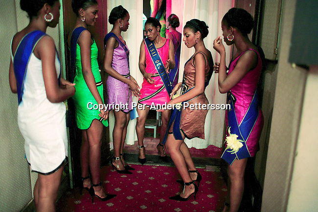 KINSHASA, DEMOCRATIC REPUBLIC OF CONGO APRIL 21: Unidentified contestants in the Miss Congo contest wait backstage to enter the stage on April 21, 2006 in central Kinshasa, Congo, DRC. About twenty girls from all over Congo, DRC competed to win the crown at the Grand Hotel in Kinshasa. Diane Muzungu from the Katanga province won. Congo DRC, returned to the Miss World contest only in 2005, after almost two decades absence. Kinshasa, a city of about eight million people is battling with bad infrastructure and no public transport. Congo, DRC is in ruins after forty years of mismanagement by the corrupt dictator and former president Mobuto Sese Seko. He fled the country in 1997 and a civil war started. The country is planning to hold general elections by July 2006, the first democratic elections in forty years.(Photo by Per-Anders Pettersson)