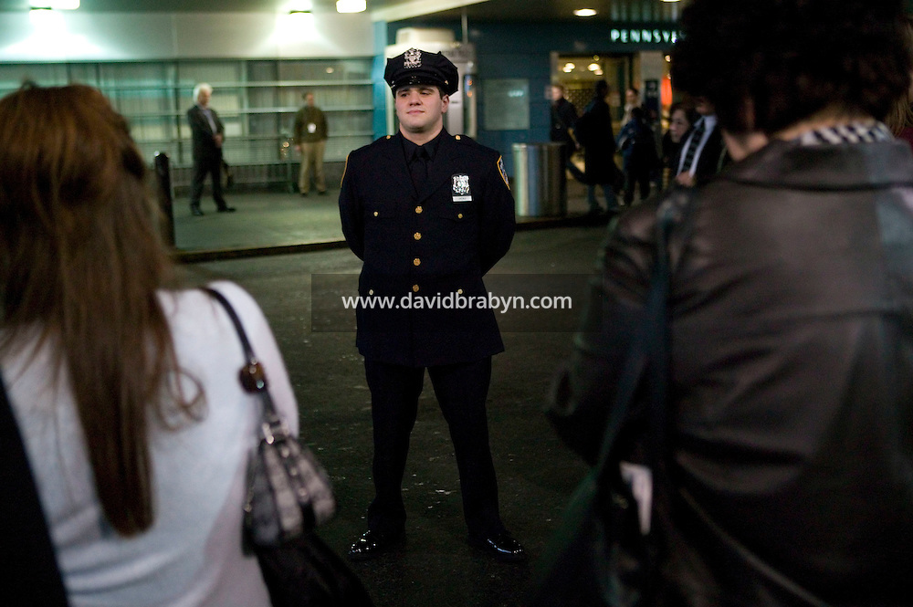 Newly sworn in Police Officer Joseph Uvenio (C) poses for his family after graduating with the NYPD Class of 2005, December 29, 2005, in New York City. 1,735 new police officers were sworn in during the ceremony.