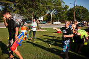 August 26, 2010. Durham, North Carolina.. The 1st annual Durham Squirt Gun and Water Balloon fight was held on the lawn of the Durham Farmer's Market. The event was sponsored by Flywheel Design and organized by word of mouth and Facebook..