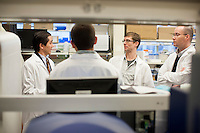 Dr. Dan Barouch speaks with researchers in his lab at the Center for Life Sciences building at Beth Israel Deaconess Medical Center in Boston, Massachusetts, USA. Pictured are Dr. Dan Barouch (left), Peter Abbink (center right, virology manager), Dr. James Whitney (right, co-author and Instructor in Medicine at Beth Israel Deaconess Medical Center and Harvard Medical School), and Dr. Rafael Larocca (center left, post-doctoral fellow).<br /> <br /> Dr. Dan Barouch is Professor of Medicine and physician at Beth Israel Deaconess Medical Center and Harvard Medical School in Boston, Massachusetts, USA. He is director of the Barouch Lab at the Center for Virology and Vaccine Research at Beth Israel Deaconess Medical Center and has recently published research on the evaluation of novel antibody therapy for HIV infection.<br /> <br /> CREDIT: M. Scott Brauer for the Wall Street Journal<br /> AIDS