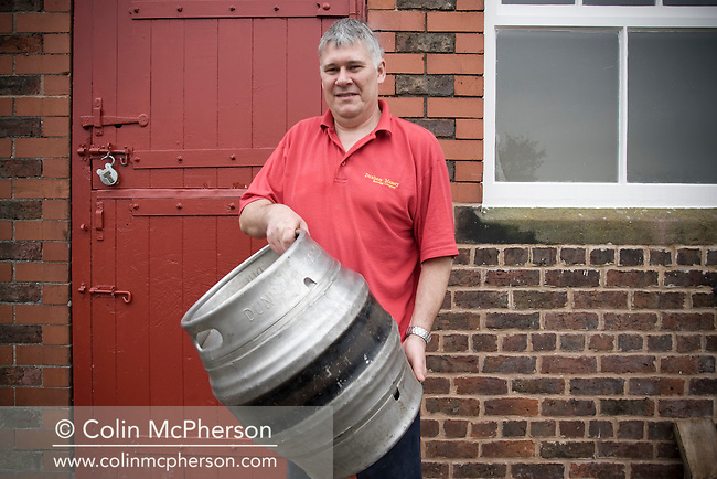 John Costello, brewer at Dunham Massey Brewing Company, based in the Cheshire village of the same name, showing off a barrel of beer made at the company he runs with other members of his family. The brewery supplies local and regional outlets and is included in the newly-established Cheshire Food Trails.