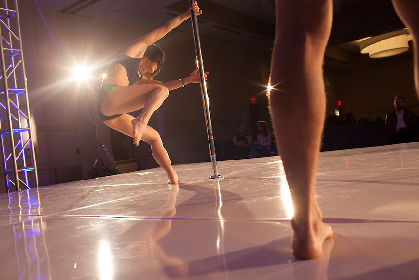 Aggie Ng of New York City, left, warms up before her performance at the 2014 Atlantic Pole Championships in Herndon, Va. on April 12, 2014. CREDIT: Lance Rosenfield/Prime for The Washington Post