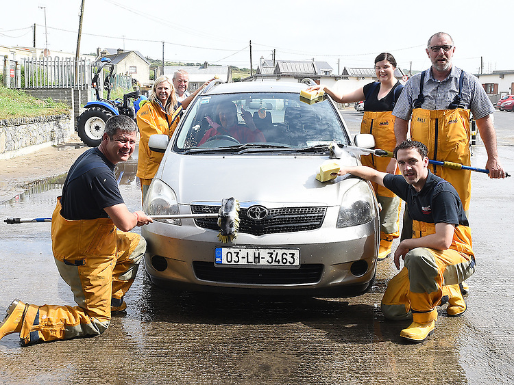 Clogherhead Lifeboat crew members Gerard Sharkey, Lisa Levins, Sean Flanagan, Eugene Conolly, Barbara Kerr and Brian Gargan pictured at their annual car wash. Photo:Colin Bell/pressphotos.ie