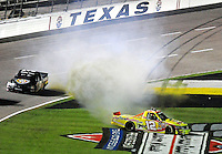 Nov. 6, 2009; Fort Worth, TX, USA; NASCAR Camping World Truck Series driver Kyle Busch (51) goes high to avoid Mario Gosselin (12) as he spins during the WinStar World Casino 350 at the Texas Motor Speedway. Mandatory Credit: Mark J. Rebilas-