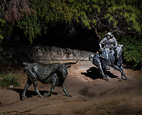 This is an image in Pioneer Plaza in downtown Dallas of a lone steer and a trail rider rounding up the wandering cow.  This plaza bronze scuptures depicts the cattle drives of the nineteen century along the  Shawnee Trail where longhorns were taken to the railroad for transport.  The bronze scuptures include 49 oversize longhorns and three trail rider cowboy along with a stream and limestone cliff giving it the feel of real time all in downtown Dallas.