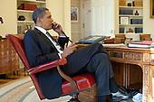 President Barack Obama talks on the phone with Haitian President René Préval in the Oval Office, Friday, January 15, 2010. .Mandatory Credit: Pete Souza - White House via CNP