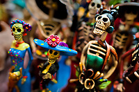 Calaca figurines are sold on the market during the Day of the Dead celebration in Mexico City, Mexico, 29 October 2016. Skulls, skeletons and the other death symbols are used to adorn graves, altars and offerings during the Day of the Dead (Día de Muertos). A syncretic religious holiday, combining the death veneration rituals of the ancient Aztec culture with the Catholic practice, is celebrated throughout all Mexico. Based on the belief that the souls of the departed may come back to this world on that day, people gather at the gravesites in cemeteries, praying, drinking and playing music, to joyfully remember friends or family members who have died and to support their souls on the spiritual journey.