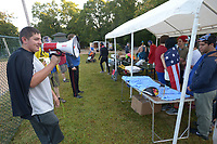 NWA Democrat-Gazette/ANDY SHUPE<br /> Hunter Bookout, 15, of Farmington, a Boy Scout in Troop 116 in Fayetteville, speaks Saturday, Sept. 9, 2017, to runners via a bullhorn before the start of the Luchador Lap at Veterans Memorial Park in Fayetteville. Bookout organized the costume-themed run as an Eagle Scout project and fundraiser raising nearly $900 for Arkansas Children's Hospital.