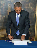"United States President Barack Obama stands after signing a book of condolence to honor those killed in the terrorist attack on the offices of Charlie Hebdo magazine in Paris, France yesterday at the Embassy of France in Washington, D.C. on Thursday, January 8, 2014.  The President's inscription reads ""On behalf of all Americans, I extend our deepest sympathy and solidarity to the people of France following the terrible terrorist attack in Paris.  As allies across the centuries, we stand united with our French brothers to ensure that justice is done and our way of life is defended.  We go forward together knowing that terror is no match for freedom and ideals we stand for - ideals that light the world.<br /> Vive la France!""<br /> Credit: Ron Sachs / Pool via CNP"