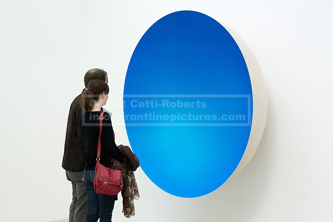 09/10/2012. LONDON, UK.  Two gallery visitors view Anish Kapoor's sculpture 'Inner Beauty' (2012) at a press view ahead of his new exhibition at the Lisson Gallery in London today (09/12/12) . The exhibition, the first since the artists solo exhibition at the Royal Academy of the Arts in 2009, features new works by Kapoor and runs from the 10th of October to the 10th of November 2012. Photo credit: Matt Cetti-Roberts
