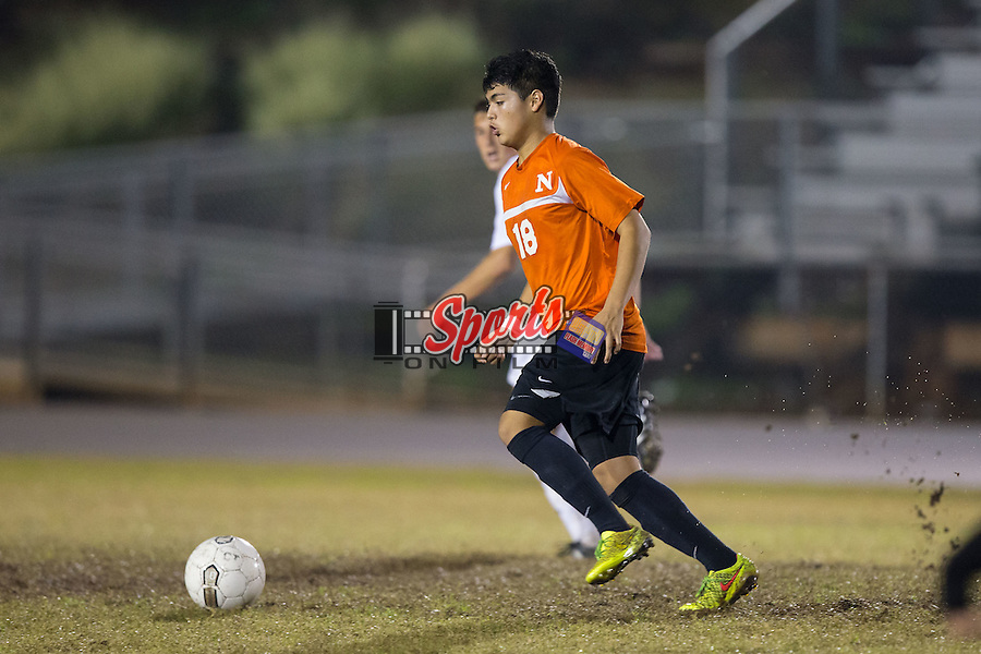 Guillermo Pacheco (18) of the Northwest Cabarrus Trojans controls the ball during first half action against the Cox Mill Chargers at Cox Mill High School on November 4, 2015 in Concord, North Carolina.  The Chargers defeated the Trojans 6-1 in the first round of the 2015 NCSHAA 3A playoffs.  (Brian Westerholt/Sports On Film)