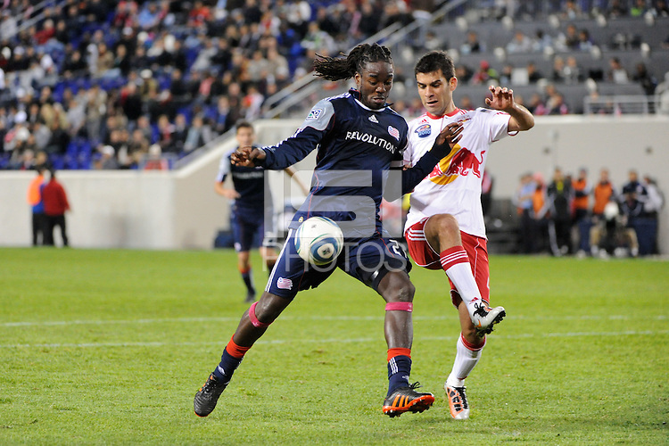 Shalrie Joseph (21) of the New England Revolution is defended by Rafael Marquez (4) of the New York Red Bulls. The New York Red Bulls defeated the New England Revolution 2-0 during a Major League Soccer (MLS) match at Red Bull Arena in Harrison, NJ, on October 21, 2010.
