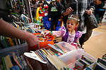 Aubriana Subia, 4, picks a book at the Friends of the Carson City Library booth at the Carson City Boo-nanza event, in Carson City, Nev., on Tuesday, Oct. 30, 2018. <br /> Photo by Cathleen Allison/Nevada Momentum