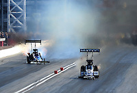 Mar. 31, 2012; Las Vegas, NV, USA: NHRA top fuel dragster driver Antron Brown (right) races alongside Cory McClenathan during qualifying for the Summitracing.com Nationals at The Strip in Las Vegas. Mandatory Credit: Mark J. Rebilas-US PRESSWIRE