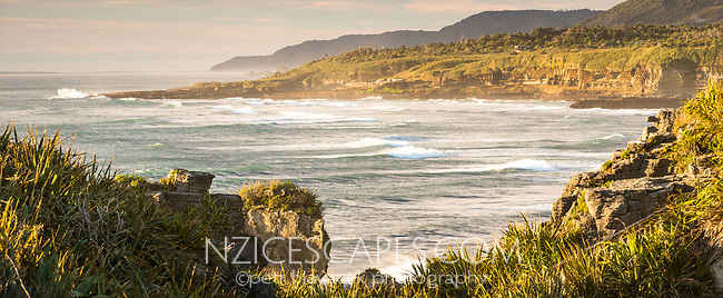 Photo of Pancake Rocks at sunset, limestone formations on wild coast in Punakaiki, Paparoa National Park, Buller Region, West Coast, New Zealand, NZ
