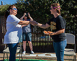 Co-founder of Kitty911 Kathy Cabrera and founder of Furry Friends Food Relief Erin Pina face off before the spaghetti toss at a fundraiser for both of these local East County non profits at the Redmen Hall in Oakley, California, on Sunday, June 28, 2015.  In addition to a spaghetti feed dinner in the hall, small plates of spaghetti could be purchased to throw at Cabrera and Pina to raise money for animal rescue in East County.  Photo/Victoria Sheridan