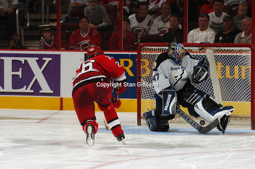 Carolina Hurricanes' Erik Cole (26) scores on the Tampa Bay Lightning's John Grahame during an exhibition shootout after their game Thursday, Sep. 22, 2005 in Raleigh, NC. Carolina won 5-2.