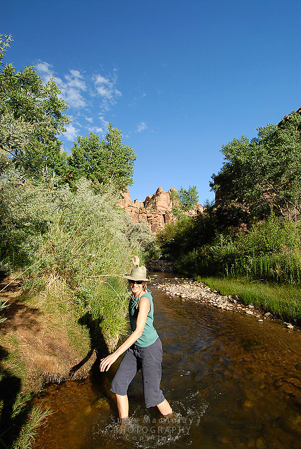 Walking and playing along an idylic desert stream bottom, South East Utah,