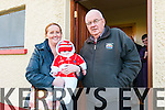 Siobhan Fitzmaurice and John Foley with little Eoghan Fitzmaurice supporting the Daingean Uí Chúis Minors during the West Keryr Minor Final in Dingle on Sunday afternoon.