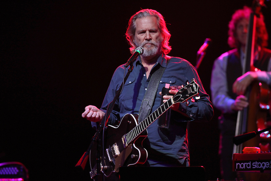 Jeff Bridges is seen performing on stage during the Jeff Bridges & The Abiders performance at The Paramount in Huntington on Friday, Aug. 29, 2014 in New York. ( photo @soulbphotos)