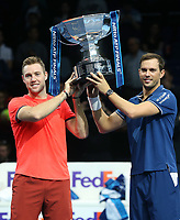 Jack Sock and Mike Bryan with their winners trophy<br /> <br /> Photographer Rob Newell/CameraSport<br /> <br /> International Tennis - Nitto ATP World Tour Finals Day 8 - O2 Arena - London - Sunday 18th November 2018<br /> <br /> World Copyright &copy; 2018 CameraSport. All rights reserved. 43 Linden Ave. Countesthorpe. Leicester. England. LE8 5PG - Tel: +44 (0) 116 277 4147 - admin@camerasport.com - www.camerasport.com