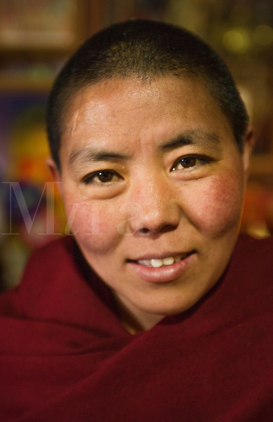 Nepal Himalayas  Buddhist nun at the Kharigandentenphelling Monastery in the village of Thamo Solukhumbu Mt Everest remote religion Buddhst nunery Buddhism  83