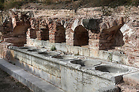 Marble basins used to wash the laundry , Cartoixa d'Escaladei (Carthusian Monastery of Santa Maria d'Escaladei), 1194, Escaladei, at the foot of the Montsant range, Priorat, Tarragona, Spain. Cartoixa d'Escaladei was the first Carthusian monastery in the Iberian peninsula. Picture by Manuel Cohen