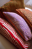 Multi-coloured cushions with graphic geometric patterns
