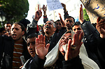 A woman lifts her hands while listening to one of many impromptu speeches during a demonstration in downtown Tunis, Tunisia, Jan. 19, 2011. This time the people demanded the Prime Minister, Mohamed Ghannouchi, step down. The protest this time was peaceful--the police did not use tear gas or other means of force to dissolve the demonstration.