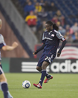 New England Revolution midfielder Shalrie Joseph (21) passes the ball. In a Major League Soccer (MLS) match, the New England Revolution defeated Sporting Kansas City, 3-2, at Gillette Stadium on April 23, 2011.
