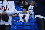 A supporter relaxing in the South Stand at the end of the game as Tottenham Hotspur took on Watford in an English Premier League match at White Hart Lane. Spurs were due to make an announcement in April 2016 regarding when they would move out of their historic home and relocate to Wembley as their new stadium was completed. Spurs won this match 4-0 watched by a crowd of 31,706, a reduced attendance figure due to the ongoing ground redevelopment.
