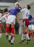 MAR 9, 2006: Faro, Portugal:  French midfielder (10) Camille Abily heads the ball away from Danish midfielder (6) Louise Hansen at the Algarve Cup in Faro, Portugal. Mandatory Credit: Photo By Brad Smith-International Sports Images.