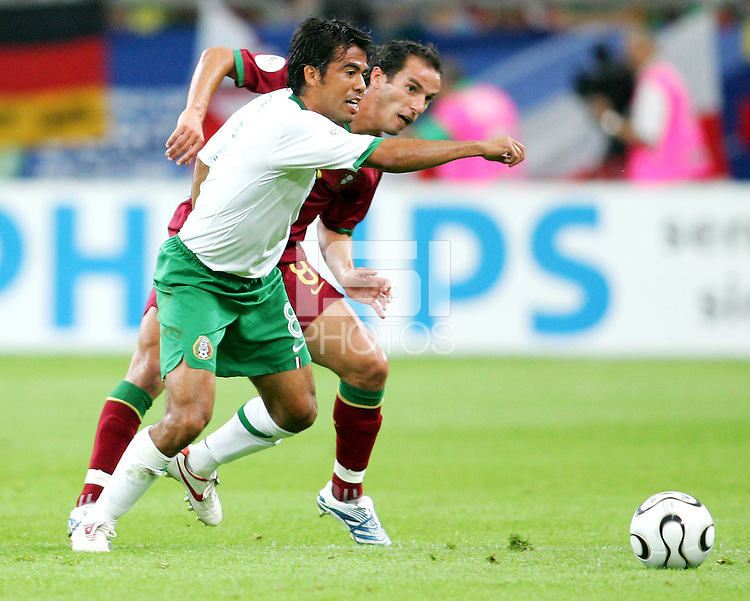 Pavel Prado (8) of Mexico struggles with Petit (8) of Portugal for the ball. Portugal defeated Mexico 2-1 in their FIFA World Cup Group D match at FIFA World Cup Stadium, Gelsenkirchen, Germany, June 21, 2006.