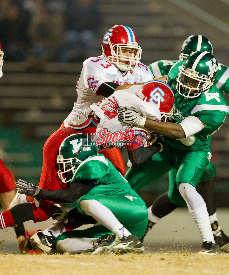 Alex Sabates (22) of the Charlotte Catholic Cougars is wrapped up by the A.L. Brown defense at A.L. Brown High School on November 26, 2010 in Kannapolis, North Carolina.  The Cougars defeated the Wonders 45-7.  (Brian Westerholt/Sports On Film)
