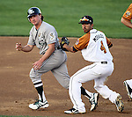 SIOUX FALLS, SD - JUNE 5:  Corey Morales #4 from the Sioux Falls Pheasants tags out David Cooper #9 from the Gary Southshore Railcats while looking at first in the fourth inning Tuesday night at the Sioux Falls Stadium. (Photo by Dave Eggen/Inertia)