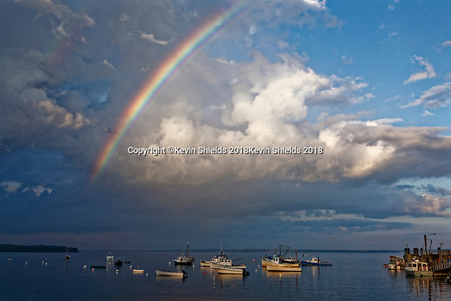 Rainbow over the harbor at Lincolnville Beach, Lincolnville, Maine, USA.