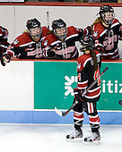 Ann Doherty (Northeastern - 16), Sonia St. Martin (Northeastern - 12) and Maggie Brennolt (Northeastern - 22) celebrate Maggie DiMasi's (Northeastern - 4) goal. - The Boston University Terriers defeated the visiting Northeastern University Huskies 3-2 on Saturday, January 28, 2012, at Agganis Arena in Boston, Massachusetts.