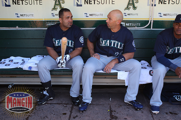 OAKLAND, CA - JUNE 15:  Kendrys Morales #8 and Raul Ibanez #28 of the Seattle Mariners talk in the dugout before the game against the Oakland Athletics at O.co Coliseum on Saturday June 15, 2013 in Oakland, California. Photo by Brad Mangin