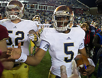 Quarterback Everett Golson (5) shakes hands after the 21-6 win.