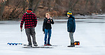 MIDDLEBURY,  CT-122619JS02- Tyler Stanley, 11, of Southbury, center, prepares his fishing rod uses an ice as he, his father Mark Stanley, left,  and friend  Max Jurkowski,  13, spent Thursday afternoon doing some ice fishing on Lake Elise in the John Largay Preserve, part of the Middlebury Land Trust. <br /> Jim Shannon Republican-American